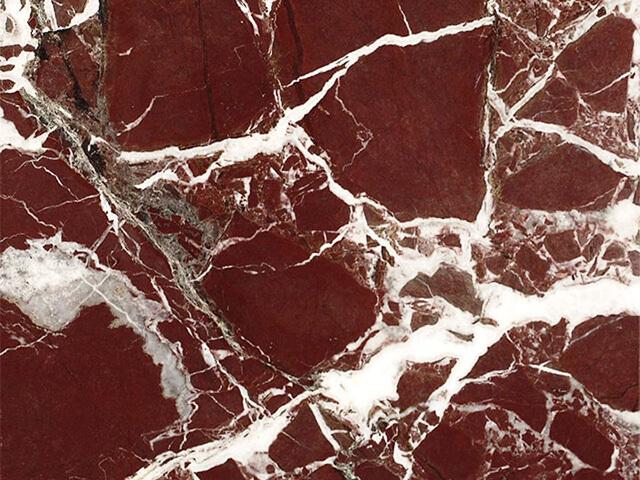 Đá Marble Rosso Levanto có màu sắc đỏ nổi bật, xen lẫn với đường vân trắng